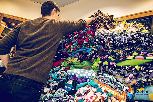 COFIA quilts are piled high at GHHS